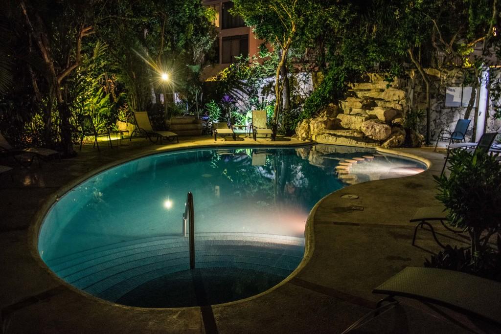 waterfall and pool at night