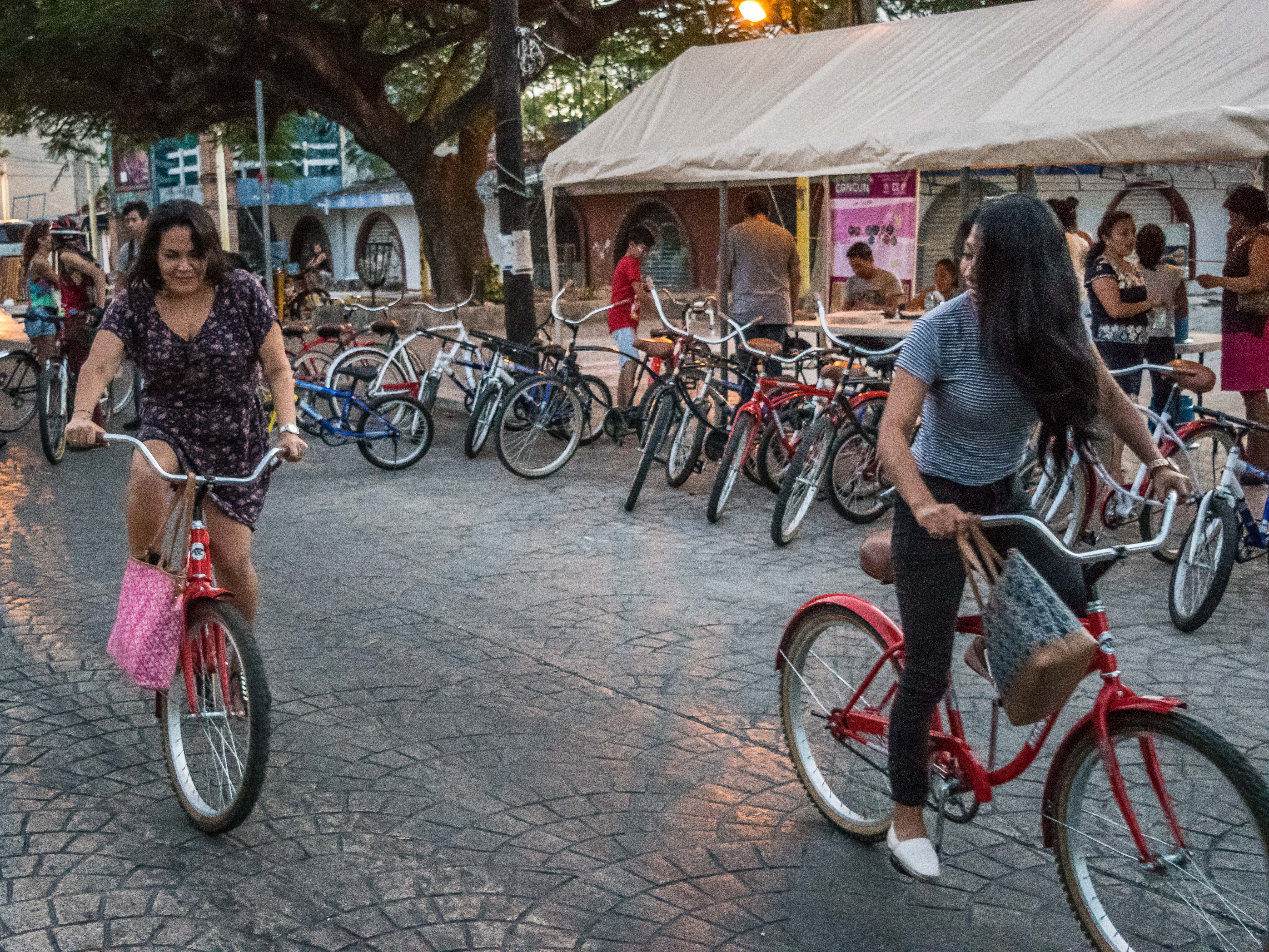 Girls on bikes at Co'ox event in Cancun