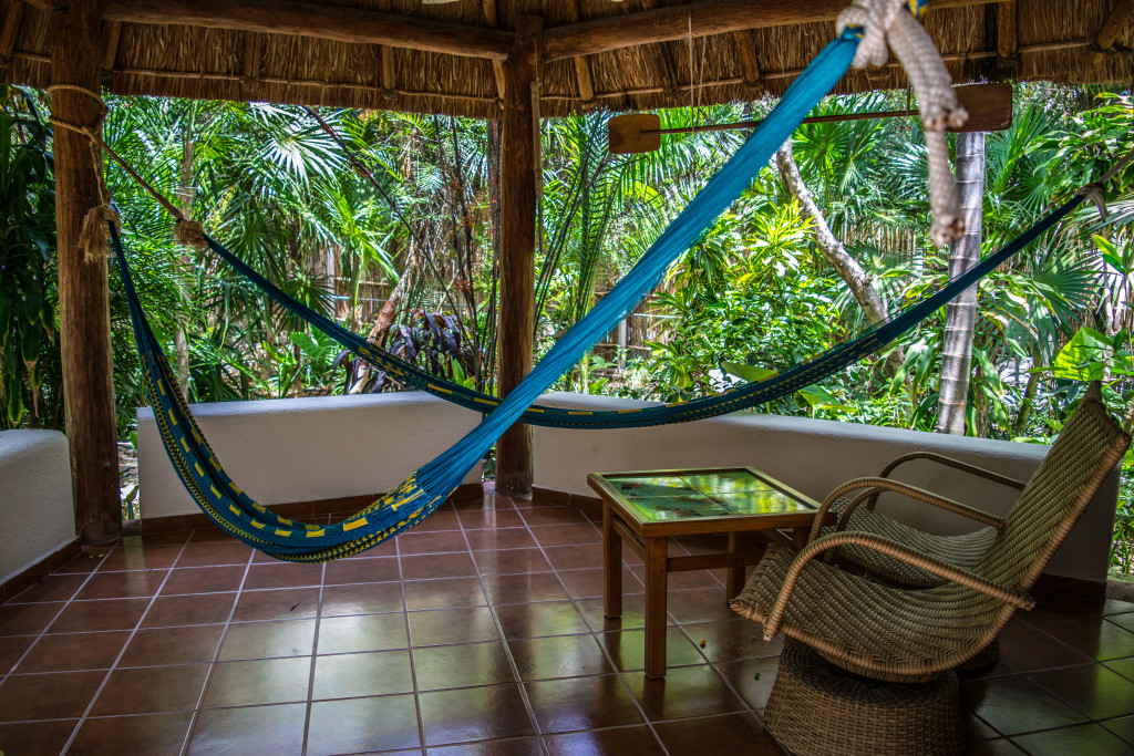 hammock and chairs on bungalow porch