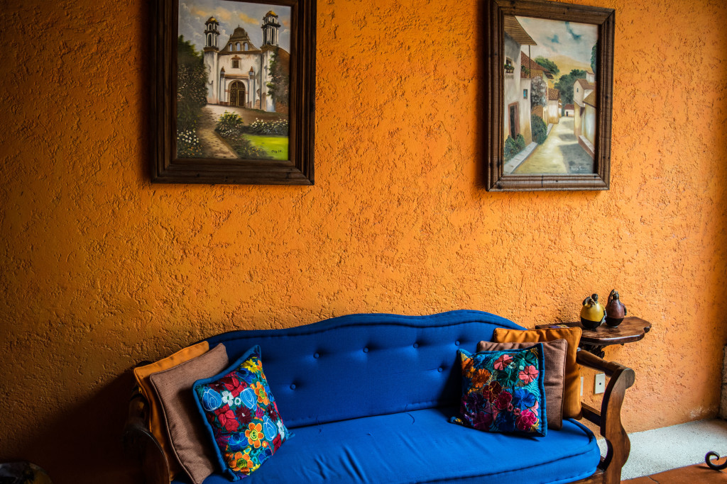 sofa and paintings in Lunata reception