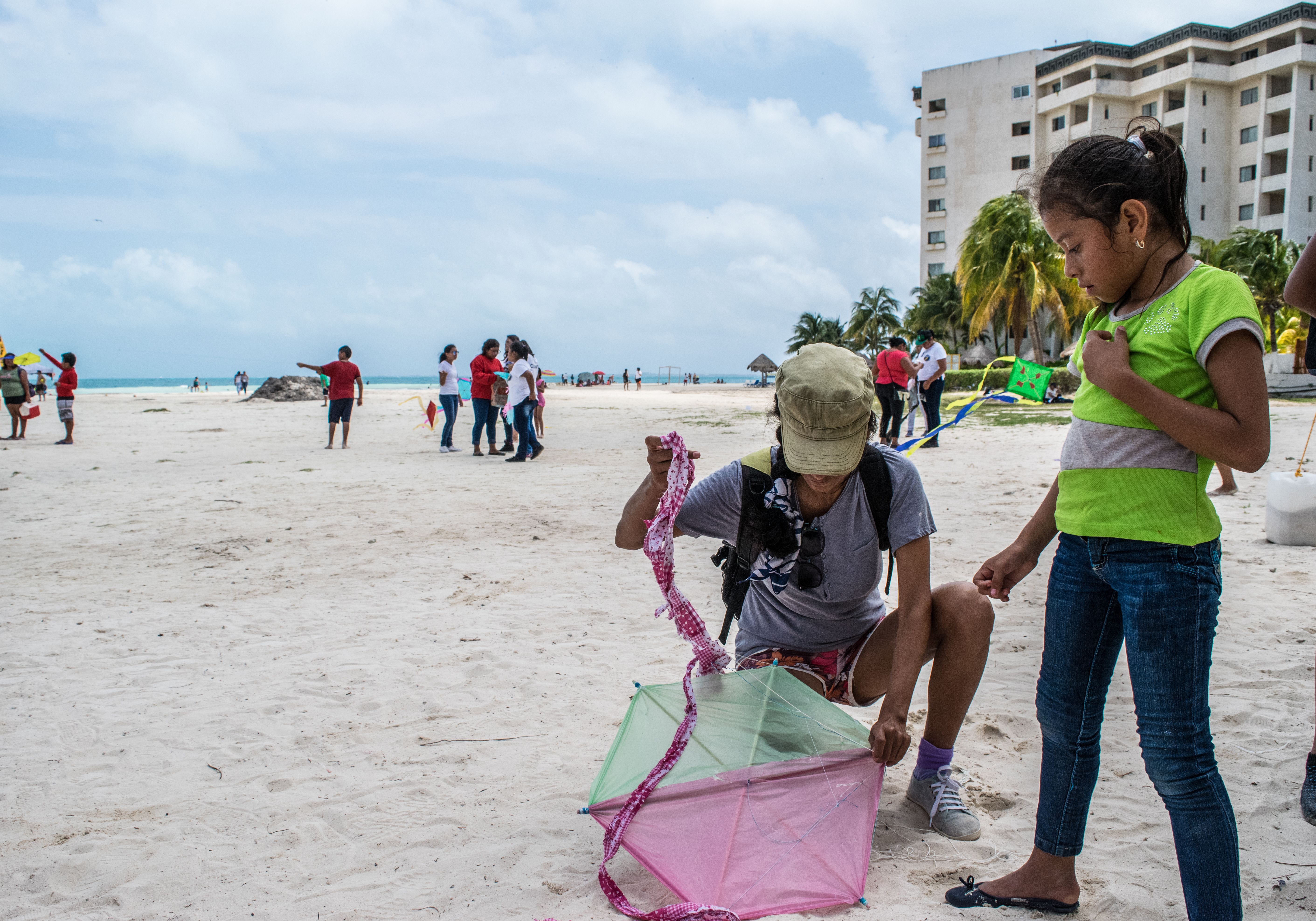Cris helping a girl with her kite