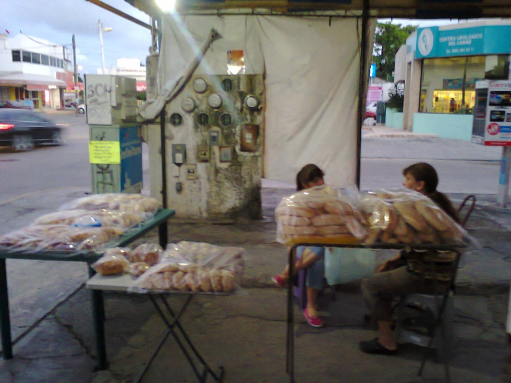family selling bread