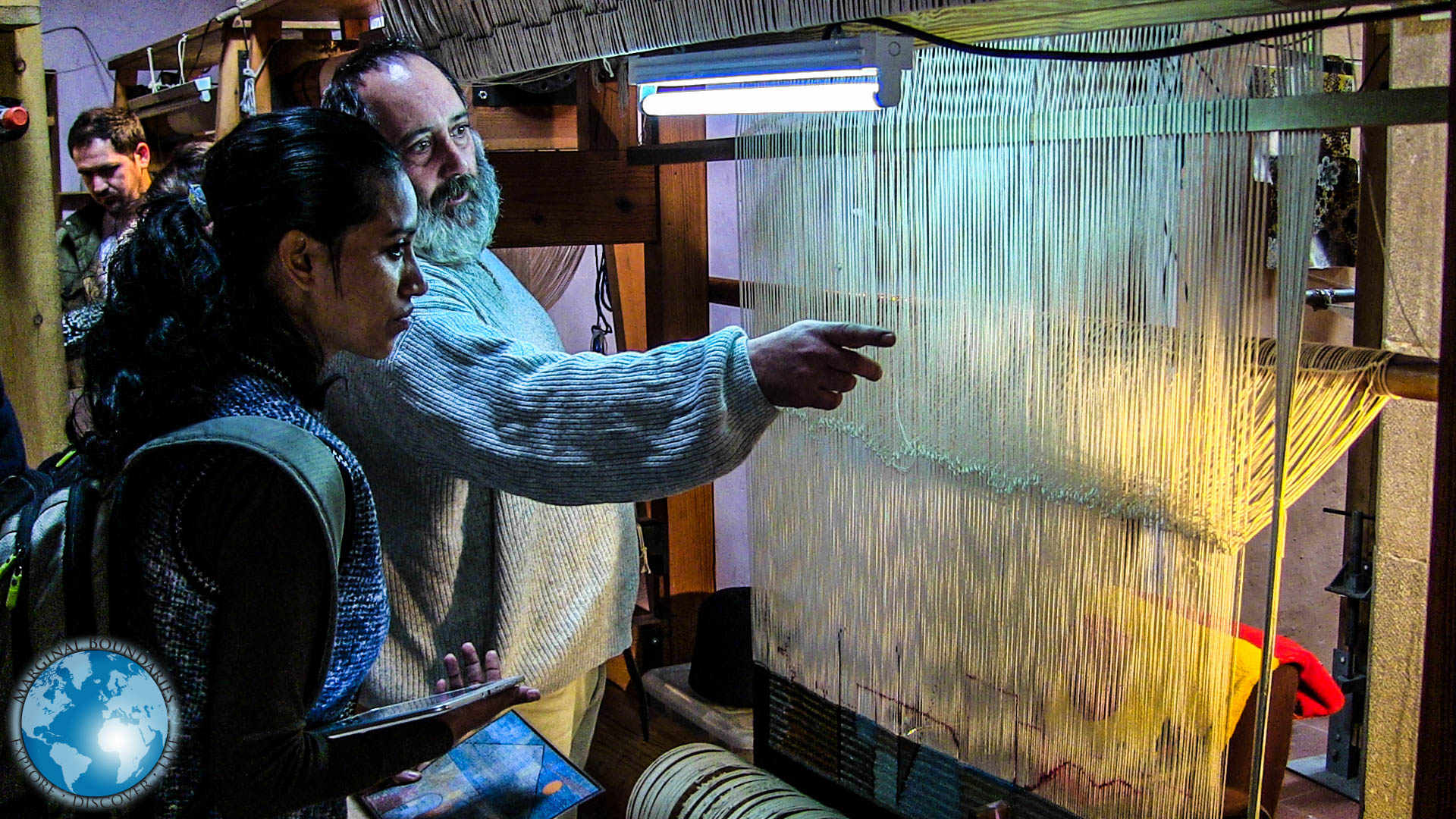 Maestro Babeus showing Cris the looms