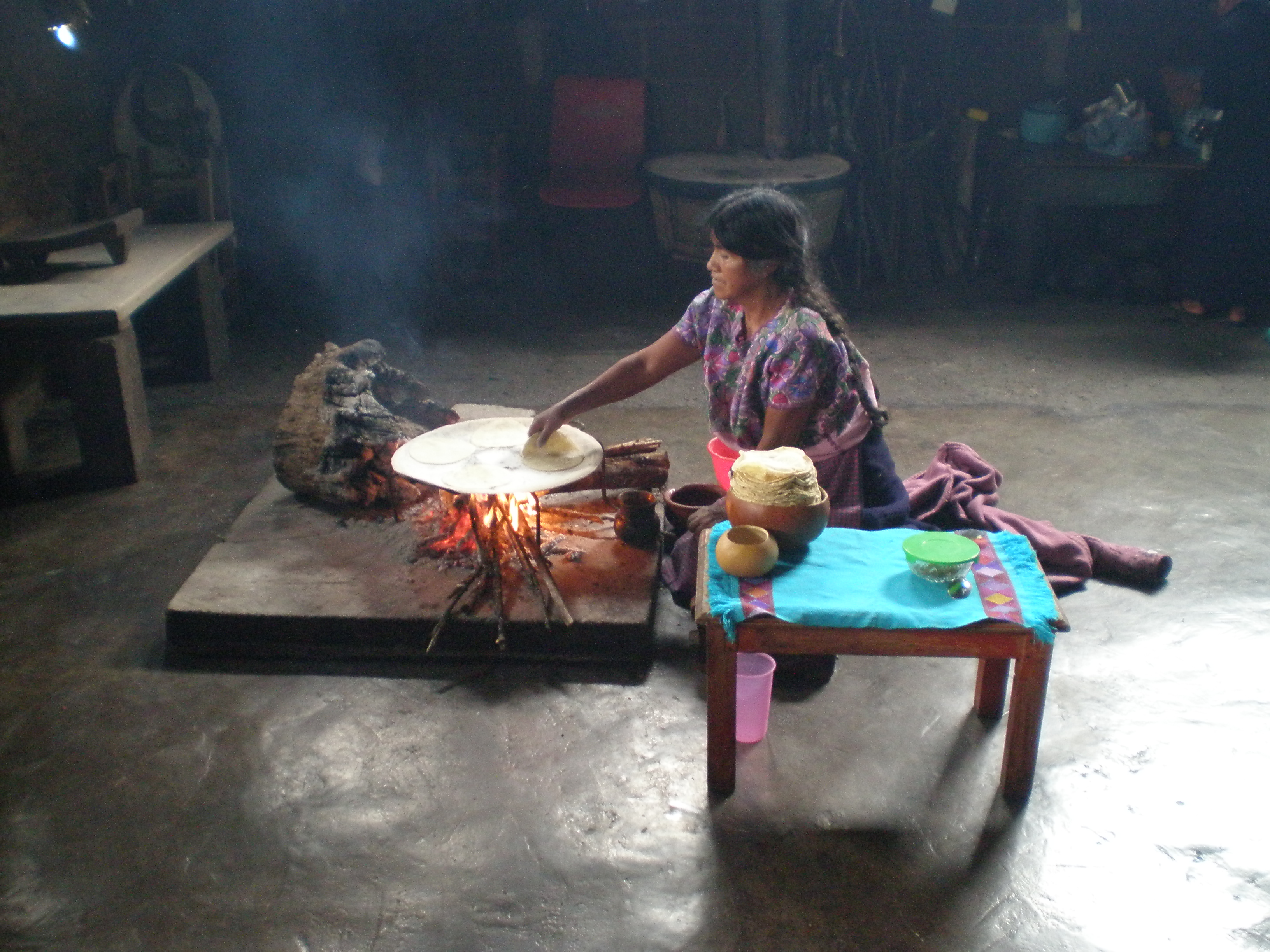 Woman making fresh tortillas in San Juan Chamula