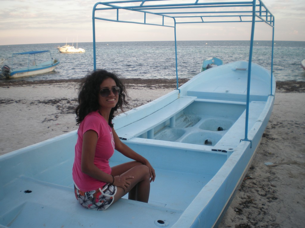 Cris sitting in a boat