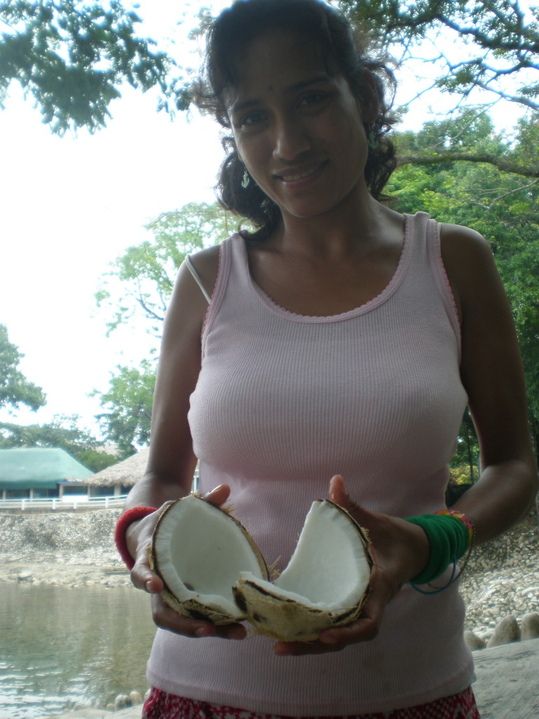 Cris breaking open a coco